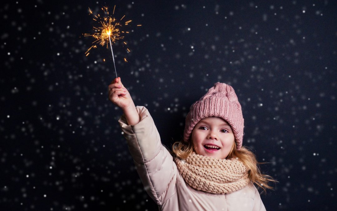 Little girl sparkling with delight